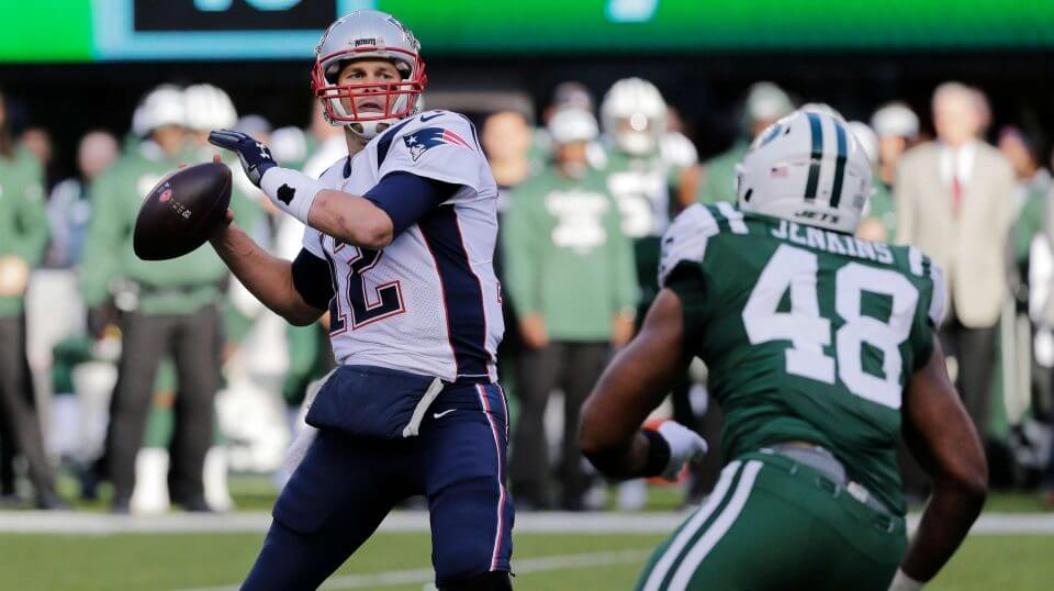 New England's Tom Brady throws a pass during the first half of his team's win over the New York Jets on Sunday.
