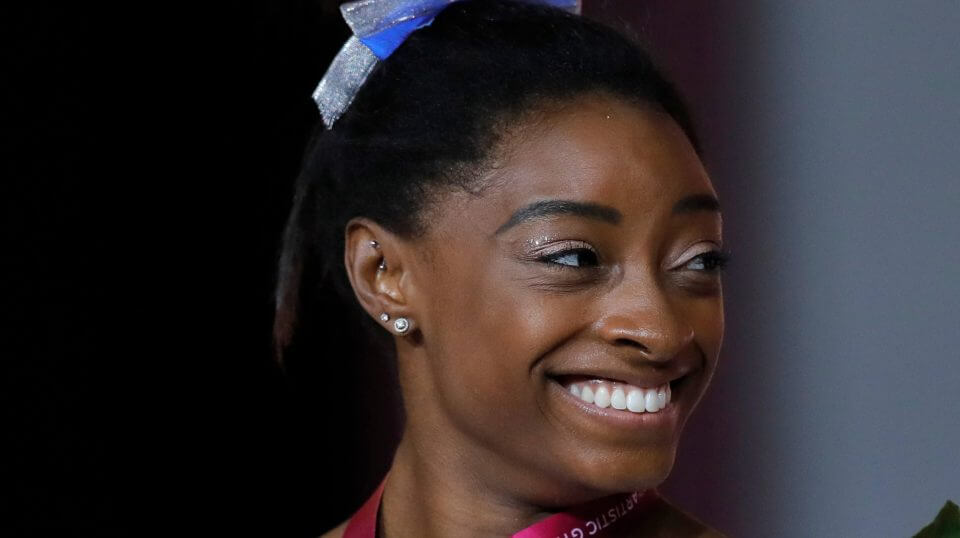 Simone Biles of the U.S. holds her silver medal after the women's uneven bars final on the first day of the apparatus finals of the Gymnastics World Championships at the Aspire Dome in Doha, Qatar, on Friday.
