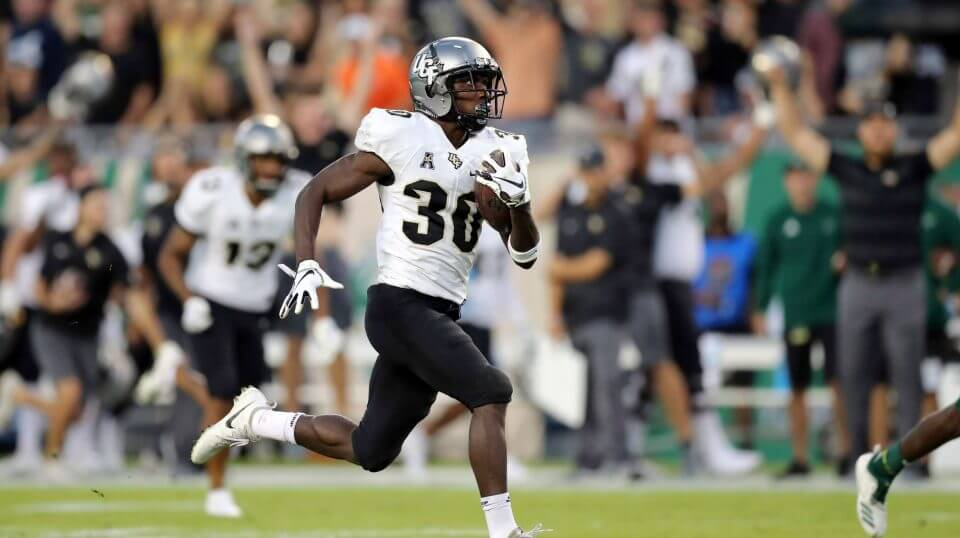 Central Florida's Greg McCrae breaks away to score a touchdown against South Florida during the first half Friday in Tampa.