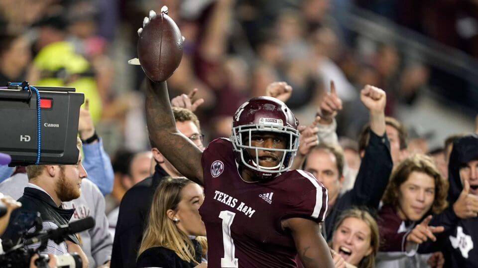 Texas A&M wide receiver Quartney Davis celebrates after catching a touchdown pass during the seventh overtime of Saturday's game against LSU in College Station, Texas.