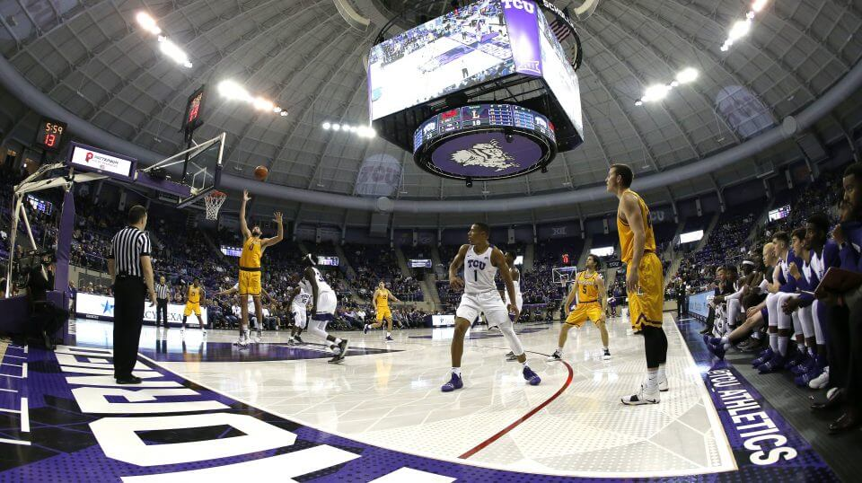 Lipscomb forward Rob Marberry (0) takes a pass inside as TCU guard Desmond Bane (1) and Lipscomb guard Garrison Mathews, right, look on during the first half Tuesday in Fort Worth, Texas.