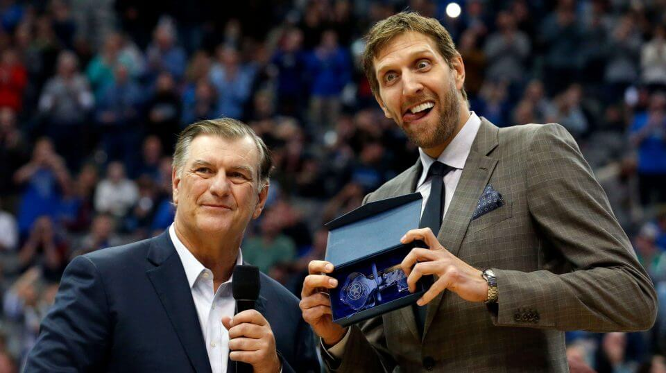 Dallas Mavericks player Dirk Nowitzki makes a face as he is presented with the key to the city of Dallas by Mayor Mike Rawlings, left, during halftime of the Mavs' game against the Brooklyn Nets on Wednesday.