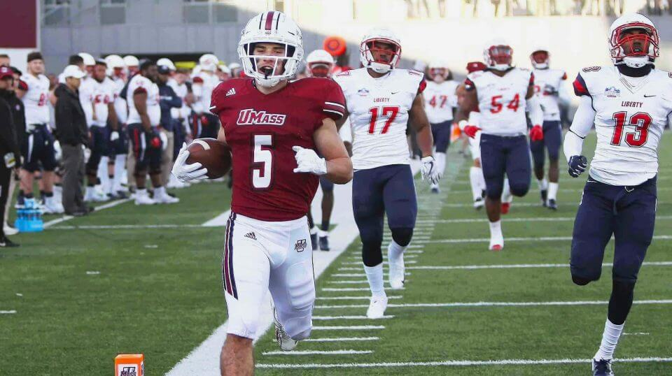 Massachusetts' Andy Isabella (5) runs into the end zone