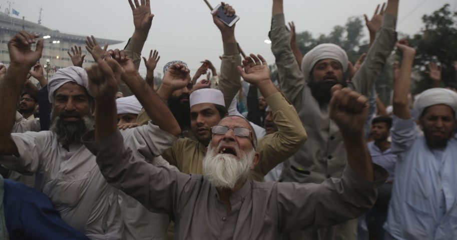 Protesters in Lahore, Pakistan, shout slogans Friday during a rally to condemn a court decision that acquitted Asia Bibi, a Christian woman who spent eight years on death row accused of blasphemy.