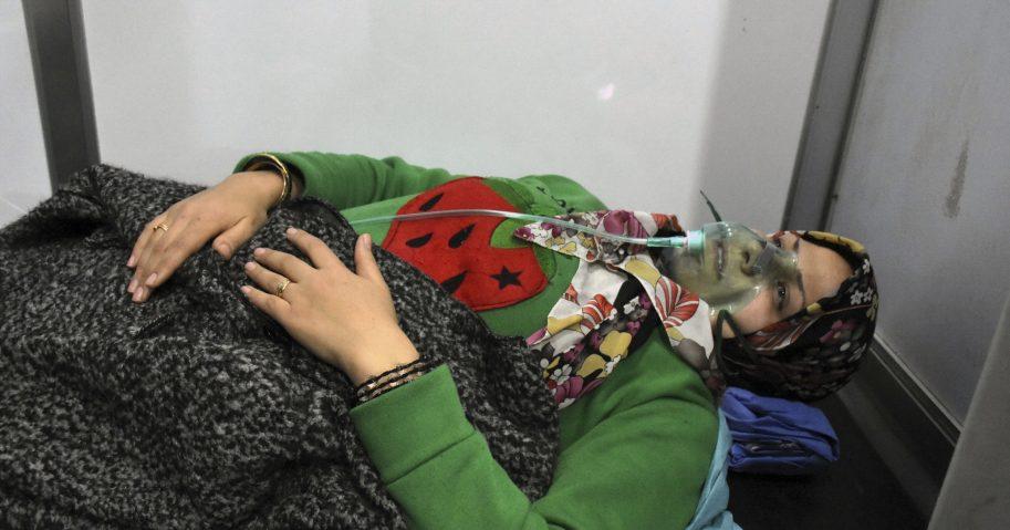 a woman receiving oxygen through respirators