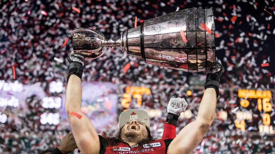 Calgary Stampeders' Alex Singleton hoists the Grey Cup after the Stampeders defeated the Ottawa Redblacks during the Canadian Football League championship game on Sunday.