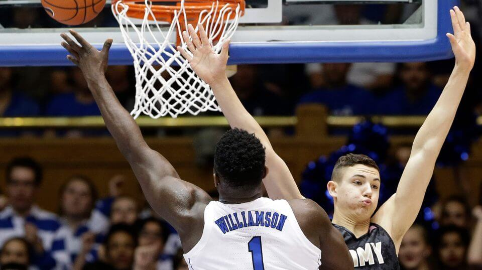 Duke's Zion Williamson (1) drives to the basket against Army's Ben Kinker (30) Sunday in Durham, North Carolina.