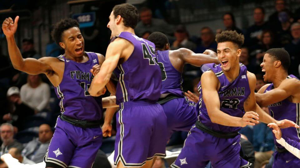 Furman players celebrate after their team defeated Villanova 76-68 in overtime Saturday.