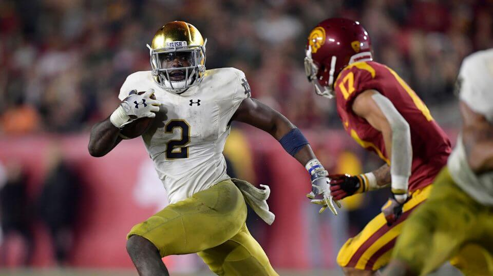 Notre Dame running back Dexter Williams, left, carries the ball as Southern California cornerback Chase Williams defends during Saturday's game in Los Angeles.