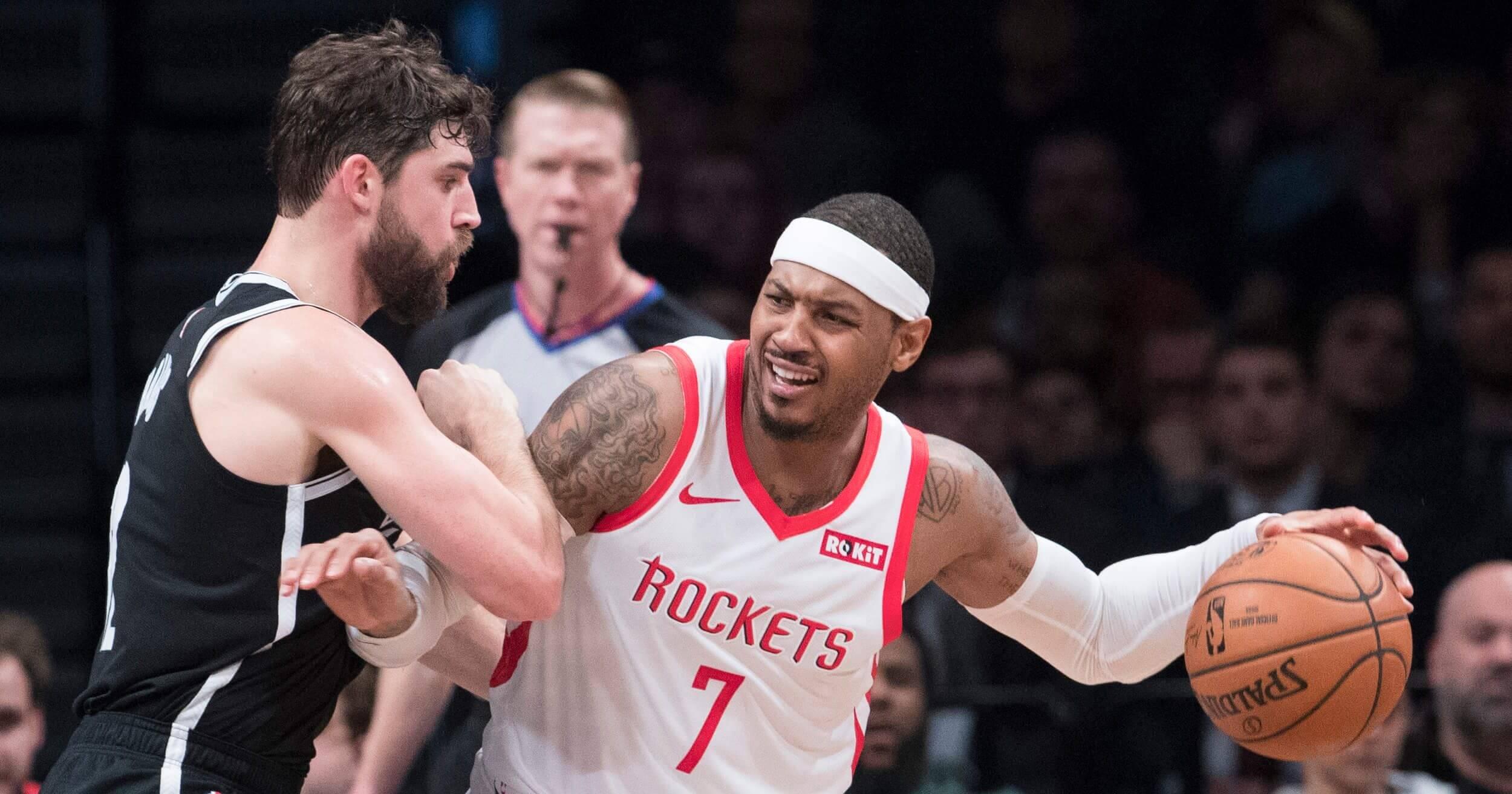 Brooklyn Nets forward Joe Harris guards Houston Rockets forward Carmelo Anthony during a Nov. 2 game in New York.
