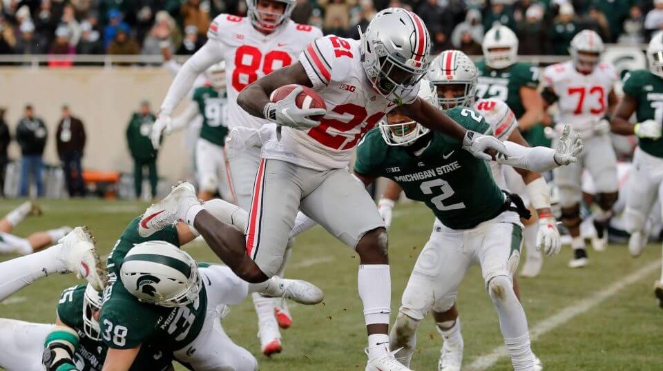 Ohio State wide receiver Parris Campbell (21) leaps over Michigan State linebacker Byron Bullough (38) to score on a 1-yard run Saturday in East Lansing, Michigan.