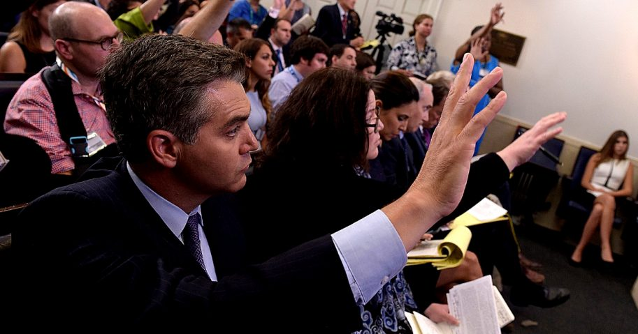 Jim Acosta of CNN raises his hand to ask a question during a press briefing at the White House.