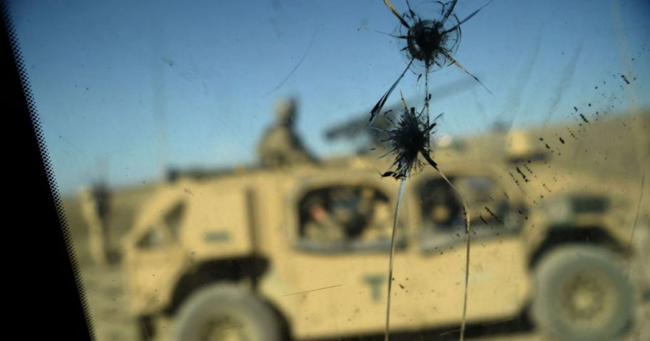 U.S. Army soldiers from NATO are seen through a cracked window of an armed vehicle in a checkpoint during a patrol against Islamic State militants in Afghanistan.