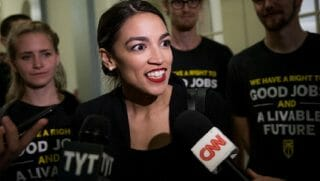 Rep.-elect Alexandria Ocasio-Cortez is interviewed by CNN while taking part in a Nov. 13 demonstration at House Minority Leader Nancy Pelosi's office in the Capitol.