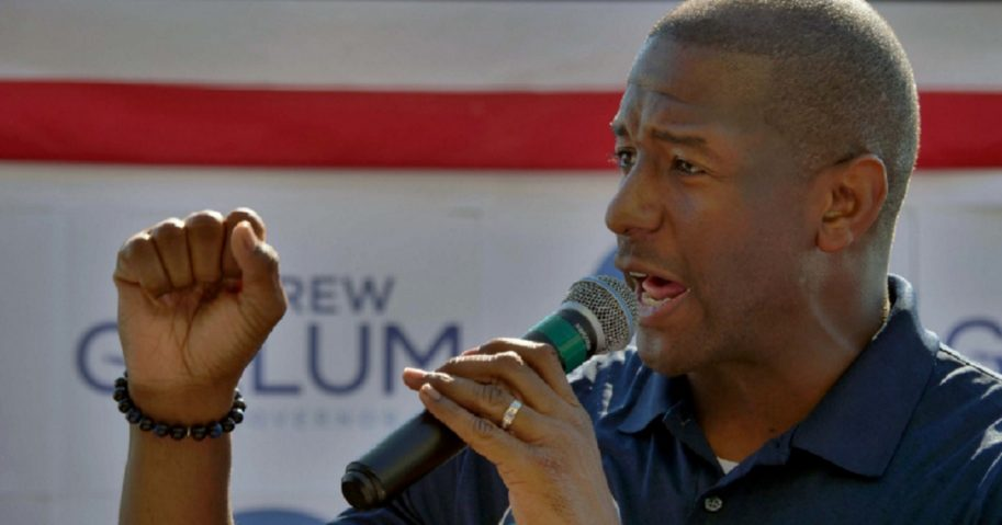 Andrew Gillum holds a microphone in an Oct. 31 file photo.