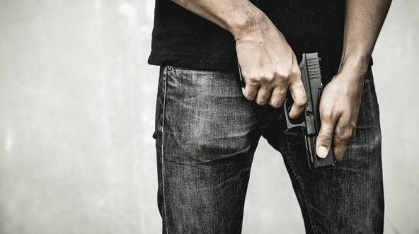 A man holding a gun.