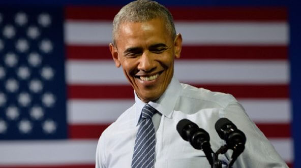 Then-President Barack Obama enjoys a chuckle onstage at a rally for Hillary Clinton in July 2016 in Charlotte, Noth Carolina.