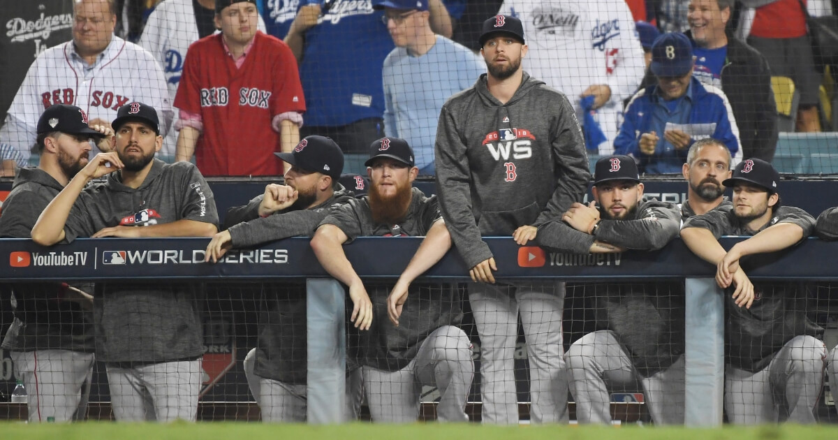The Boston Red Sox look on from the dugout during Game 3 of the World Series at Dodger Stadium.
