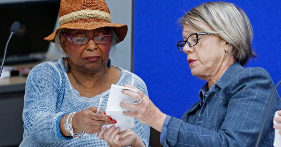 Brenda Snipes, left, Broward County Supervisor of Elections, speaks with Judge Betsy Benson, canvassing board chair, prior to the start of a recount of all votes at the Broward County Supervisor of Elections Office