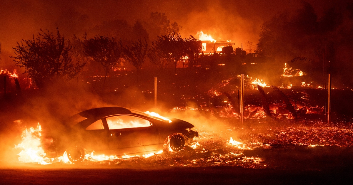 Vehicles and homes burn as the Camp fire tears through Paradise, California, on Nov. 8.