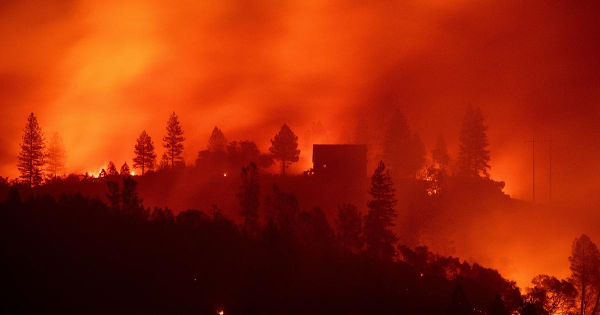Flames from the Camp fire burn near a home atop a ridge near Big Bend, California, on Nov. 10, 2018.