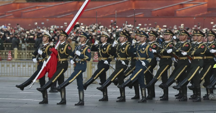 Chinese officers march in a flag-raising ceremony in Beijing in January.