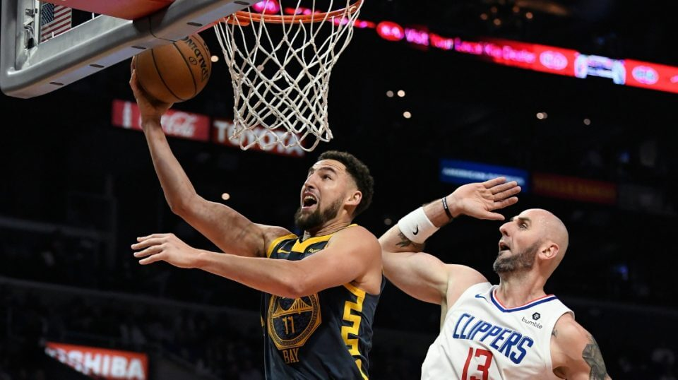 Klay Thompson of the Golden State Warriors attempts a layup against Marcin Gortat of the Los Angeles Clippers on Nov. 12 at Staples Center.