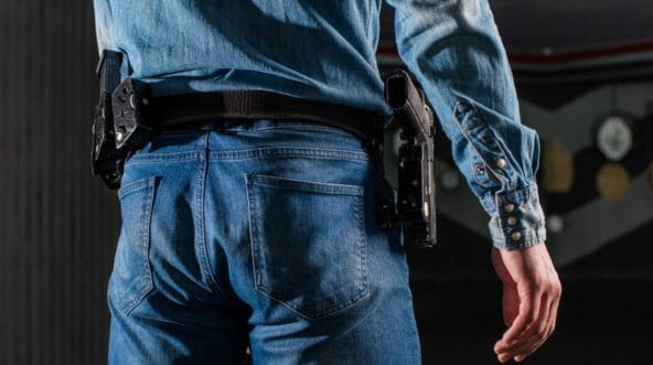 A man with a holstered gun
