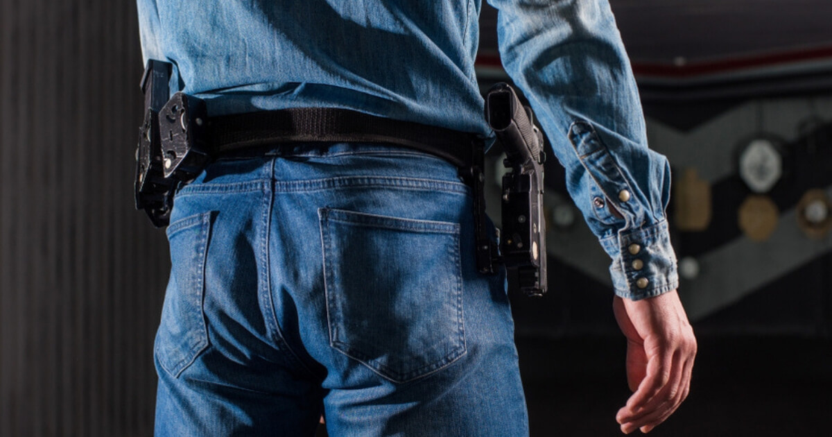 A man with a holstered gun