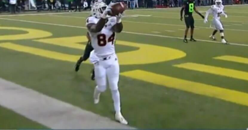 Arizona State's Frank Darby tries to keep his foot inbounds on a catch