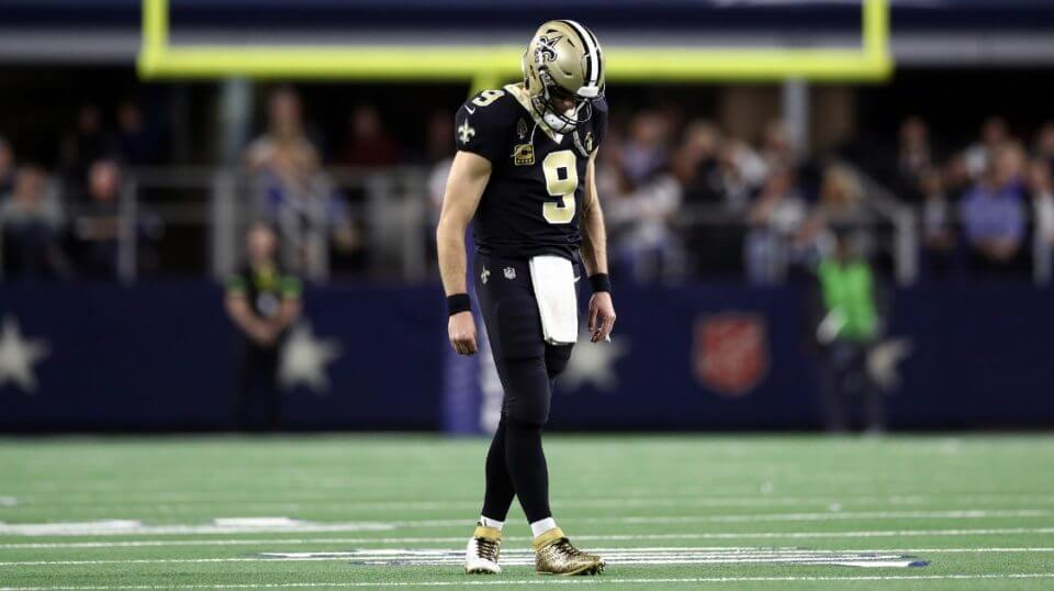 Drew Brees of the New Orleans Saints walks off the field during Thursday night's game against the Dallas Cowboys at AT&T Stadium.