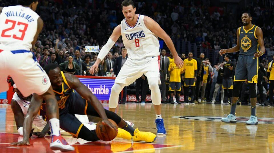 Kevin Durant, right, of the Golden State Warriors is visibly annoyed when teammate Draymond Green loses control of the ball in the final seconds of the fourth quarter against the Los Angeles Clippers on Monday.