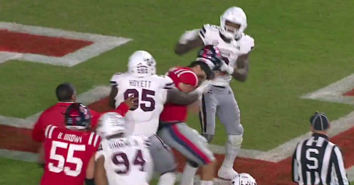 Players from Ole Miss and Mississippi State brawl in the Egg Bowl.