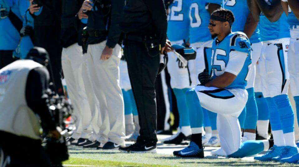 Eric Reid of the Carolina Panthers kneels during the national anthem prior to the team's Oct. 28 game against Baltimore.