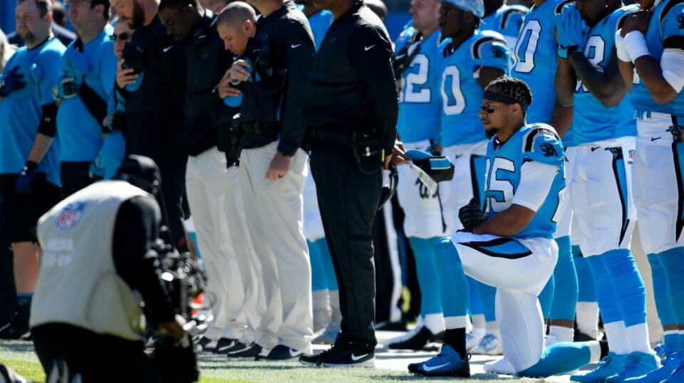 Eric Reid of the Carolina Panthers kneels in protest during the national anthem before a game against the Baltimore Ravens on Sunday.