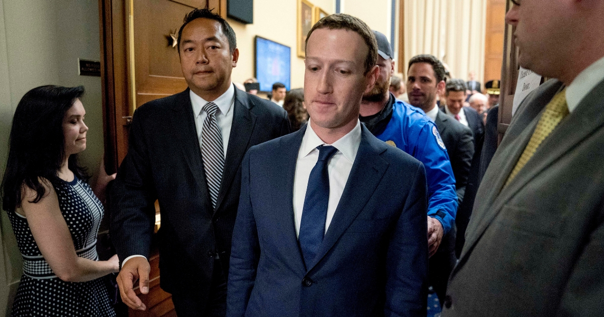 Facebook CEO Mark Zuckerberg departs after testifying before a House Energy and Commerce hearing on Capitol Hill in Washington, April 11, 2018.