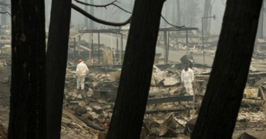 Rescue workers search for human remains Tuesday at a trailer park destroyed by the Camp Fire in Paradise, California.