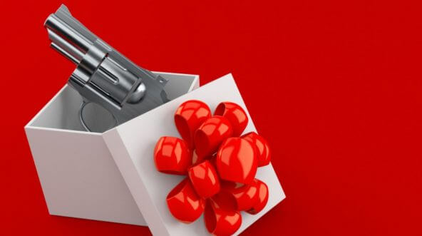 A revolver in a gift-wrapped box