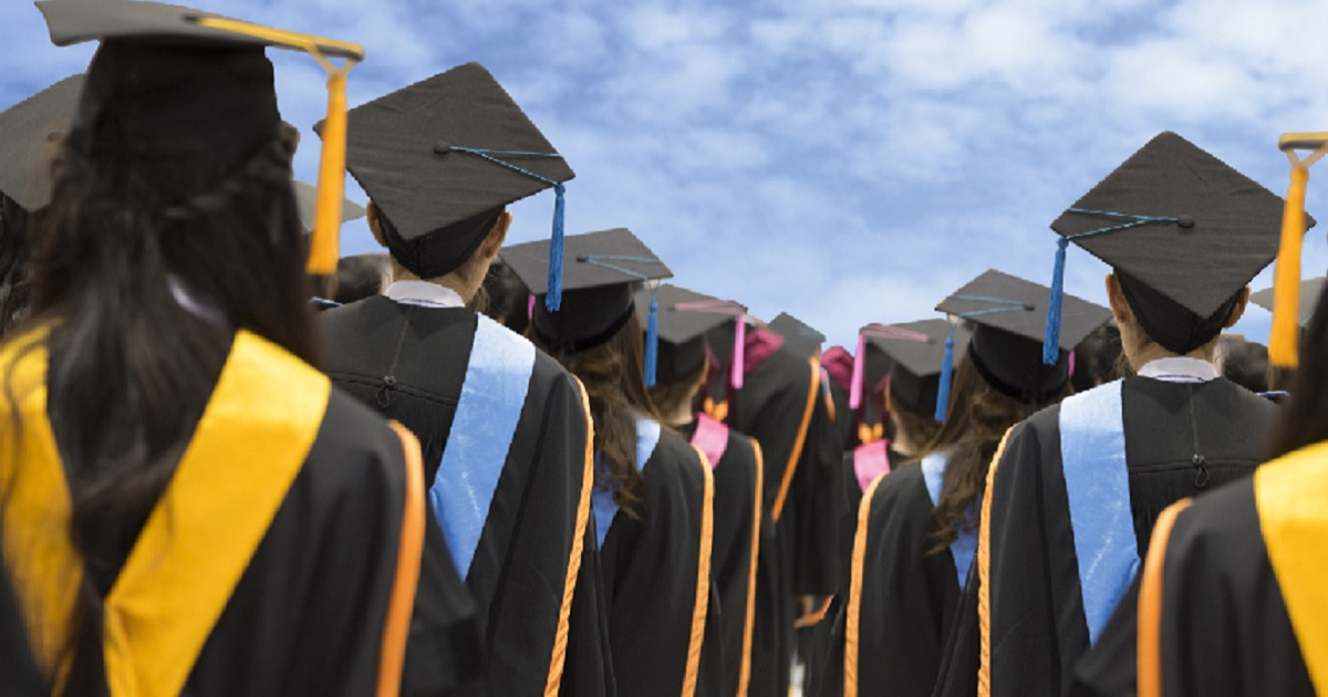 Picture of graduates in caps and gowns, from the back.