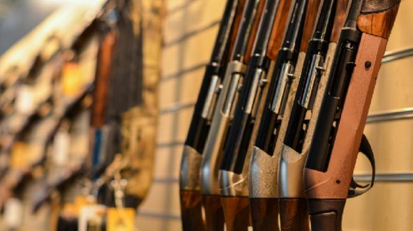 Rifles lined up for sale.