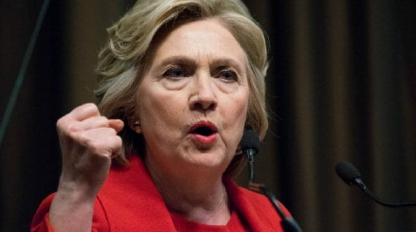 Hillary Clinton clutches her fist in a file photo from 2016.