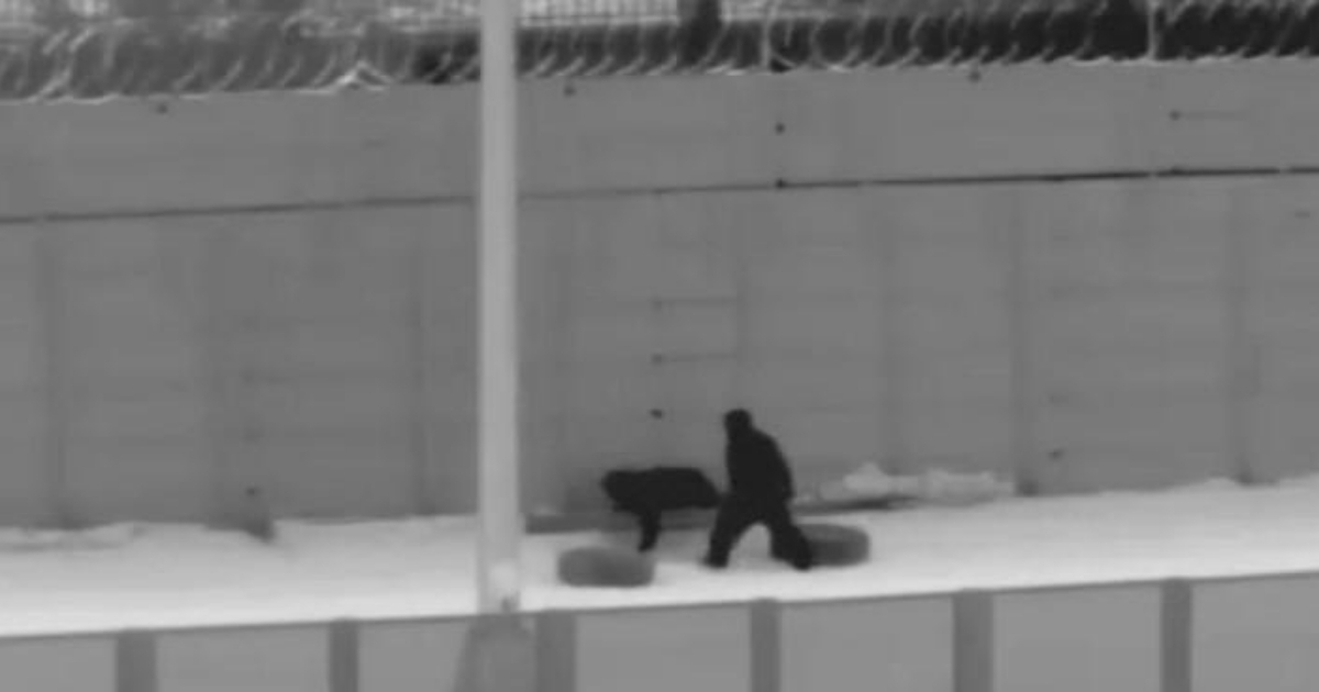A Border Patrol camera captures Illegal immigrants crawling under the fencing east of the San Luis Port of Entry near Yuma, Arizona.
