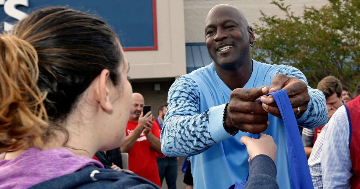 NBA legend Michael Jordan greets people and hands out food for Thanksgiving to members of the community in Wilmington, North Carolina, on Tuesday.