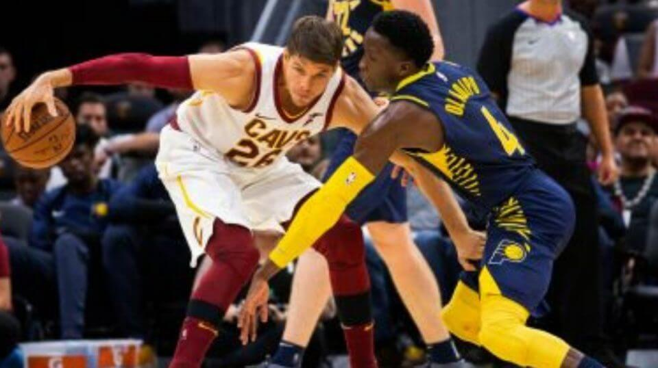 Kyle Korver with the Cleveland Cavaliers protects the ball from a defender