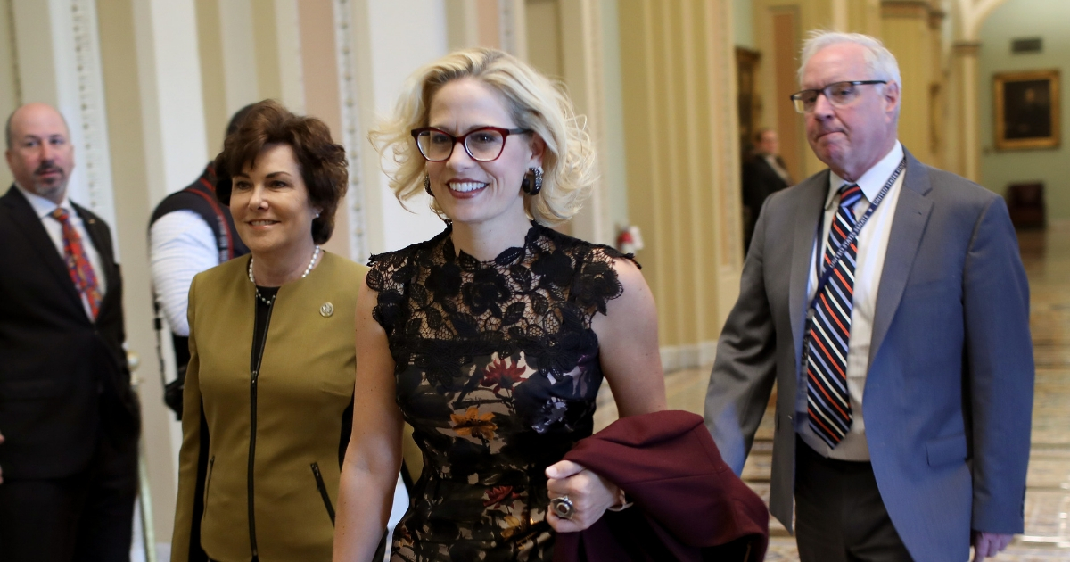 Newly-elected Democratic senators-elect Kyrsten Sinema (L) (D-AZ) and Jacky Rosen (R) (D-NV) walk to the office of Senate Minority Leader Chuck Schumer for a meeting at the U.S. Capitol Nov. 13, 2018, in Washington, DC..