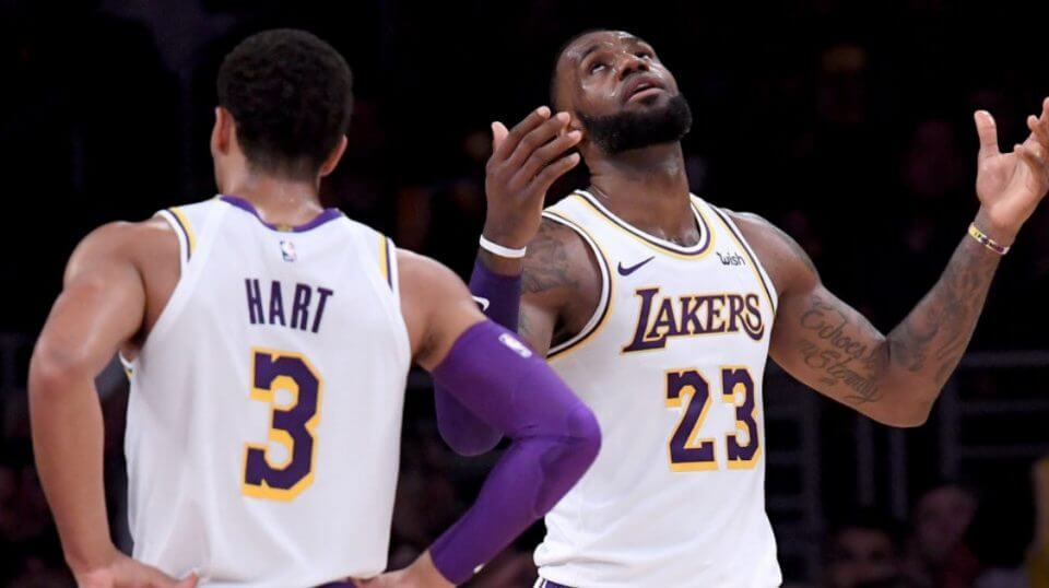 Josh Hart and LeBron James of the Lakers looking frustrated