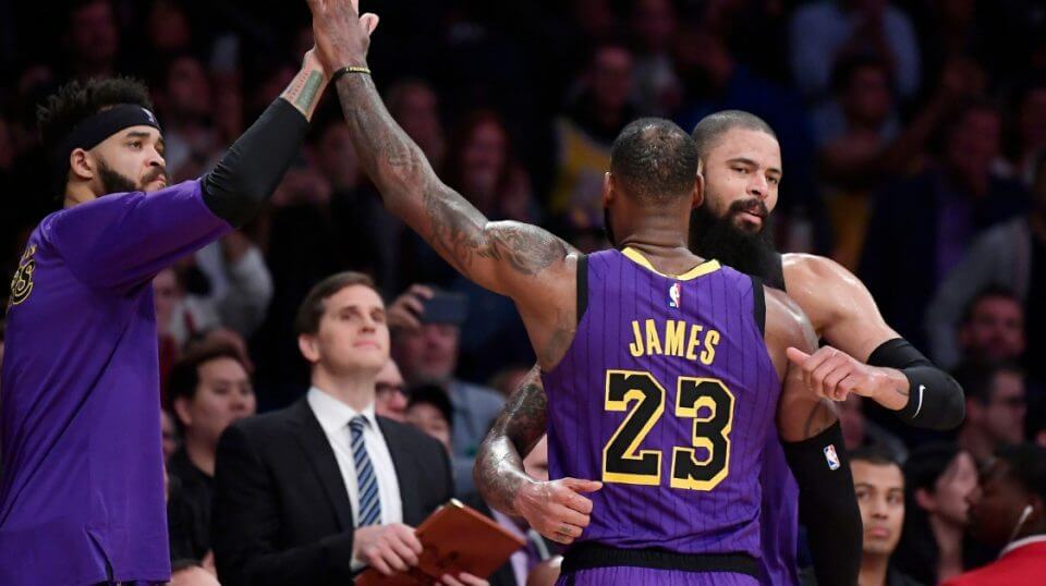 LeBron James is congratulated by teammates JaVale McGee, left, and Tyson Chandler