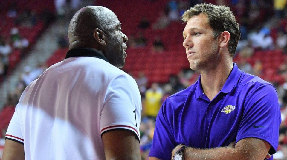 "Earvin ""Magic"" Johnson, Lakers president of basketball operations, talks to coach Luke Walton during the NBA Summer League in Las Vegas."