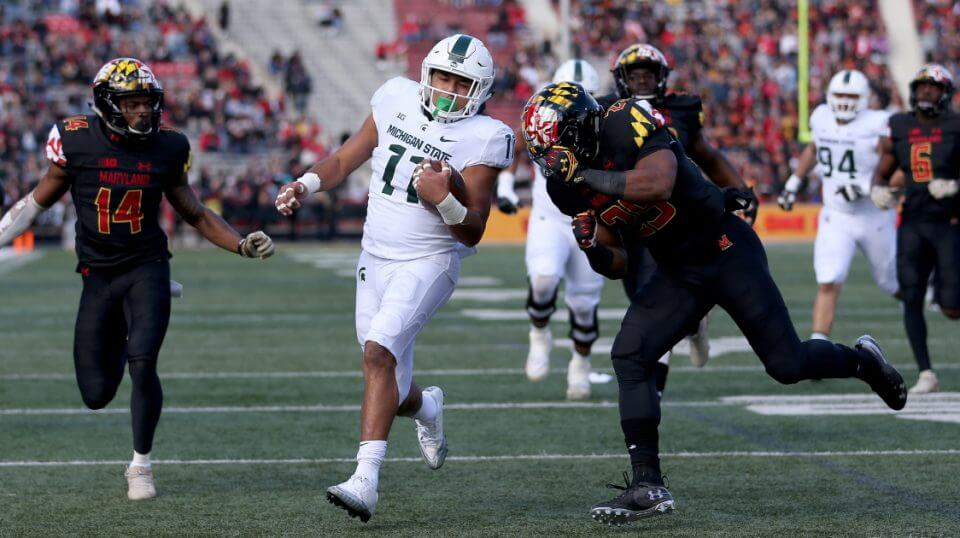Connor Heyward of the Michigan State Spartans scores a touchdown past Deon Jones, left, and Antoine Brooks Jr. of the Maryland Terrapins on Saturday in College Park.