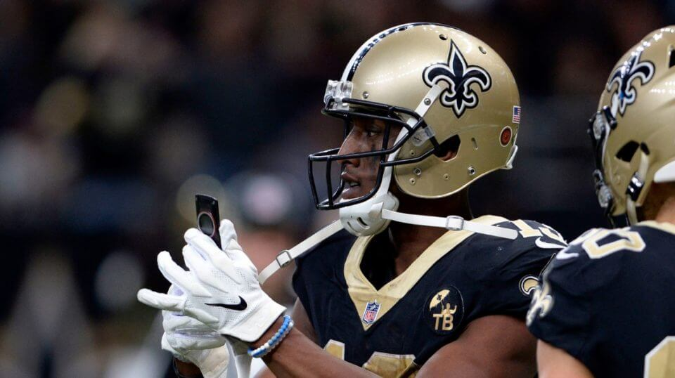 New Orleans Saints wide receiver Michael Thomas pulls out a cell phone after his 72-yard touchdown reception in the second half of the Saints' win over the Los Angeles Rams on Nov. 4.